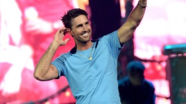 NASHVILLE, TN - MARCH 26:  (EXCLUSIVE ACCESS, SPECIAL RATES APPLY) Musical artist Jake Owen performs onstage during Kenny Chesney's The Big Revival 2015 Tour kick-off for a 55 show run through August. The high-energy opening night included 2 ? hours of music, including five songs from his #1 The Big Revival, surprise guests and a leaner, cleaner stage and 2.3 million pixel screen that gave the sold out house the best view theyve ever had of the 8-time Entertainer of the Year at the Bridgestone Arena on March 26, 2015 in Nashville, Tennessee  (Photo by Rick Diamond/Getty Images for Kenny Chesney)
